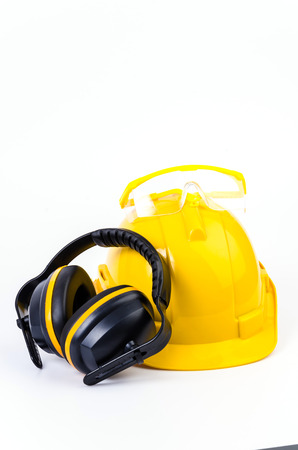 cautious: Safety equipment on isolated white background , Safety helmet , ears protection , eyes protection