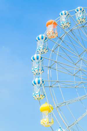 Amusement ferris wheel in the park photo