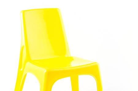 patio chair: Yellow plastic chair on isolated white background