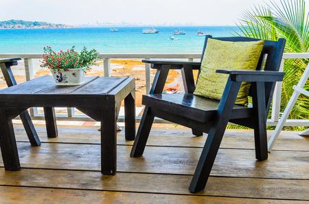 Wood chair on the beach photo