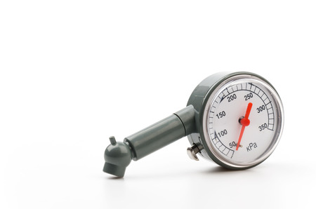 Tire pressure gauge isolated white background photo