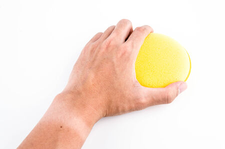 Hand holding sponge isolated on white background photo