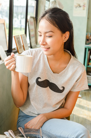 Girl in coffee shop photo