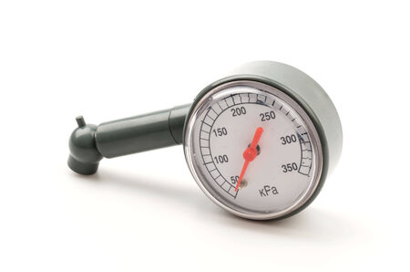 Tire pressure gauge isolated on white background photo