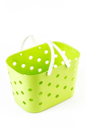 Plastic basket on isolated white  photo