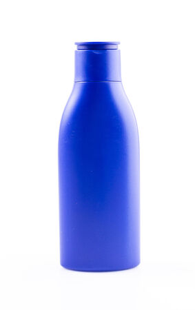 Lotion bottle on isolated white background photo