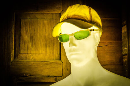 mannequin wear cap and sunglasses photo