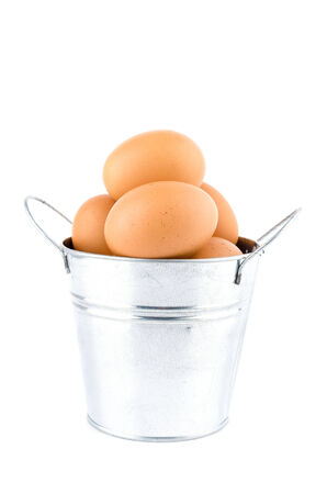 Eggs bucket isolated white background photo