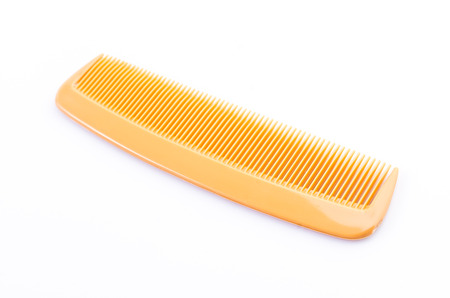 plastic comb: Comb on isolated white background