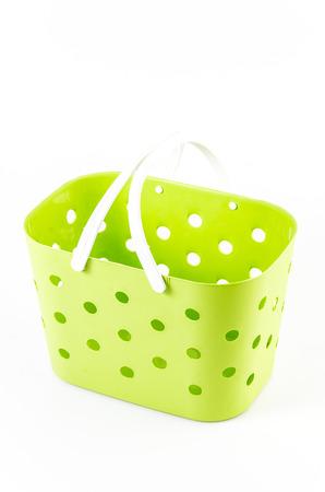 Plastic basket on isolated white background photo