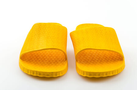 Yellow slippers isolated white background photo