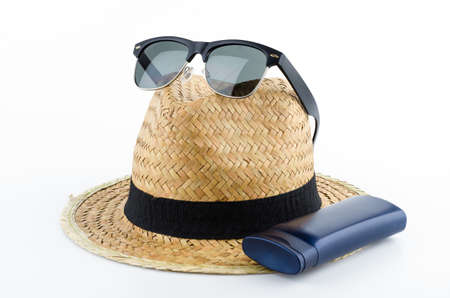 Hat , sunglasses , body lotion isolated on white background photo