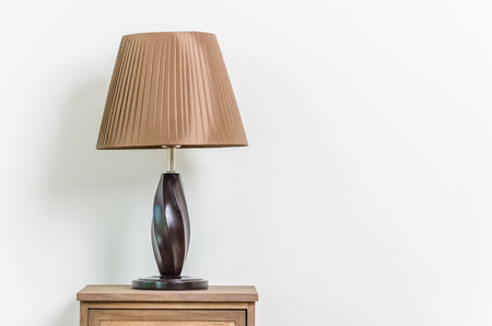 Lamp on bedside table interior room photo