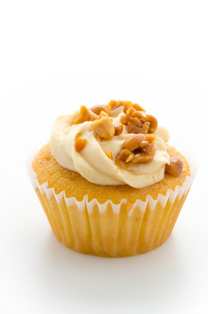 Nuts cupcake isolated on white  photo