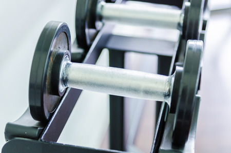 adjustable dumbbell: Gym equipment with close up selective focus to a dumbbell