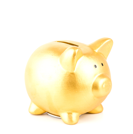 piggie bank: gold piggy bank isolated white