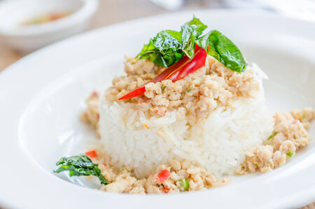 Spicy fried chicken with basil and rice photo