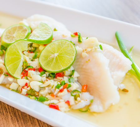 Steamed basa fish in lime dressing photo