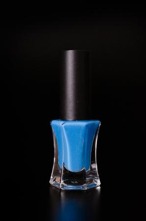 Nail polish on black background photo