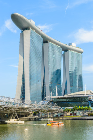 SINGAPORE - June 2014:Front view of the Marina Bay Sands Resort at the mouth of the Singapore River June 25, 2014 in Singapore. This waterfront resort and casino is a tourist attraction.