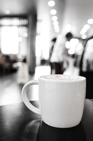 Coffee cup in coffee shop interior photo