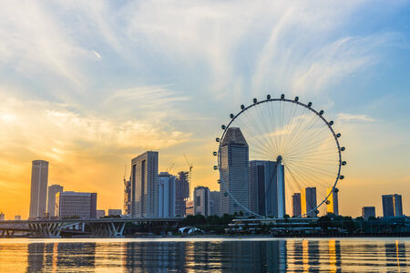 observation wheel: SINGAPORE - JUNE 23: At a height of 165m, Singapore Flyer is the largest Giant Observation Wheel in the world.