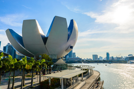 SINGAPORE - JUNE 24: ArtScience Museum on JUNE 24, 2014 in\ Singapore. It is one of the attractions at Marina Bay Sands. It has\ 21 gallery spaces with a total area of 6,000 square meters.\