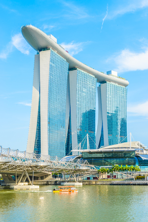 SINGAPORE-JUNE 24: The Marina Bay Sands Resort Hotel in\ Singapore. It is an integrated resort and the world\'s most\ expensive standalone casino property at S$8 billion.\