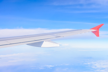 Looking through window aircraft during flight in wing with a nice blue sky photo