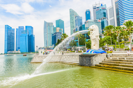 SINGAPORE - JUNE 22, 2014: View of Singapore Merlion at Marina Bay against Singapore skyline. Merlion is a well-known tourist icon, mascot and national personification of Singapore photo