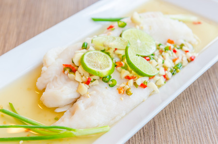 Steamed basa fish in lime dressing