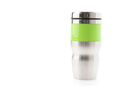 Thermos coffee mug isolated on white photo
