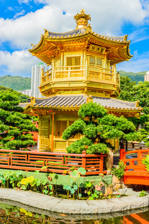 chinese temple: Gold Chinese pavilion at the park of Hong Kong Editorial