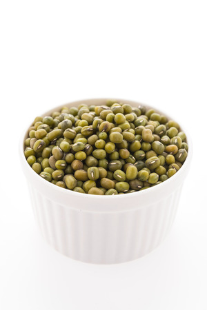 Green mung beans isolated on white background photo