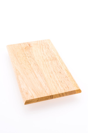 Wooden cutting board isolated on white background photo