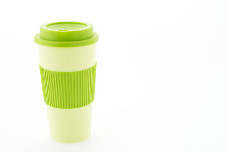 Green plastic coffee mug isolated on white background photo
