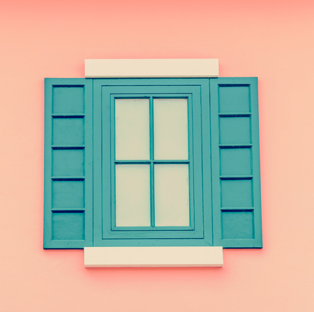 Beautiful window on color wall process vintage instagram effect style picture photo