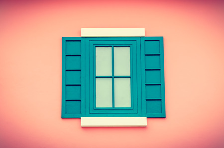 Beautiful window on color wall process vintage  effect style picture photo