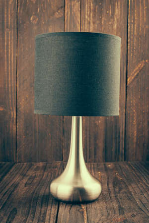 Lamp on wood background - vintage effect style photo