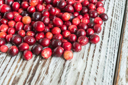 Cranberry on wooden background photo