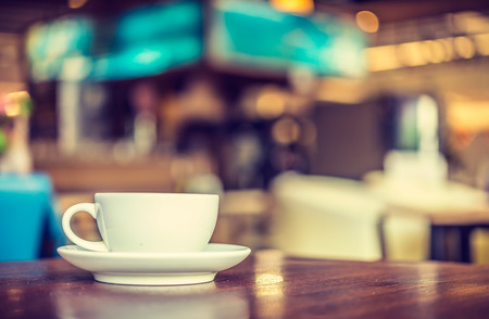 coffee shops: Coffee cup in coffee shop - vintage style effect picture