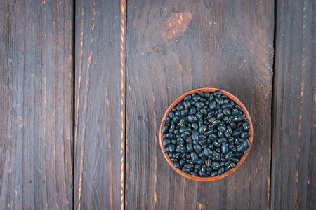 turtle bean: Black beans on wooden - vintage effect style pictures Stock Photo