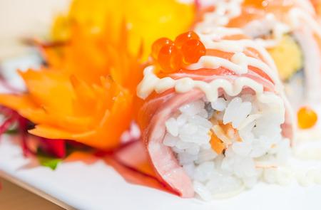 Salmon sushi roll - selective focus