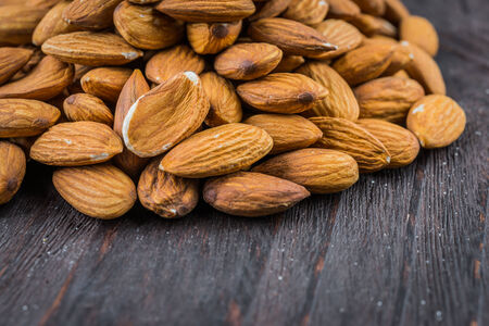 raw food: Almond on wooden background - vintage old effect stlye pictures