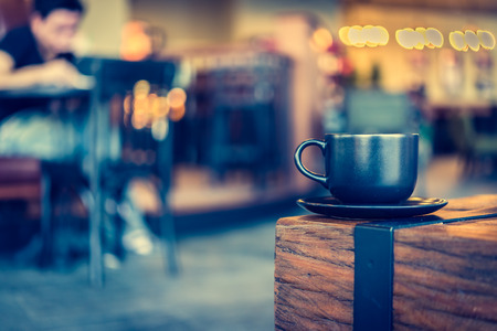 black coffee mug: Coffee mug in coffee shop cafe - Vintage effect style pictures Stock Photo