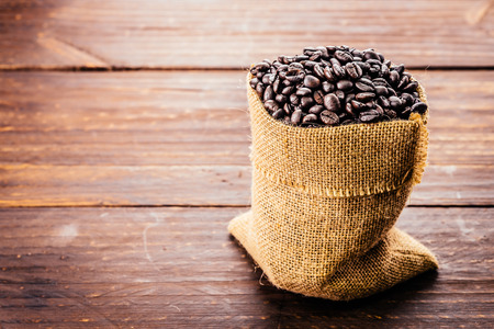 Coffee beans on wood background - Vintage effect style pictures photo