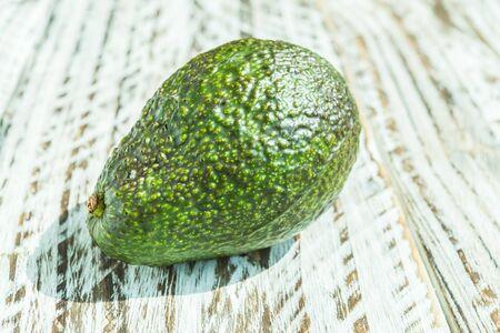 halved  half: Avocado fruit on wooden background