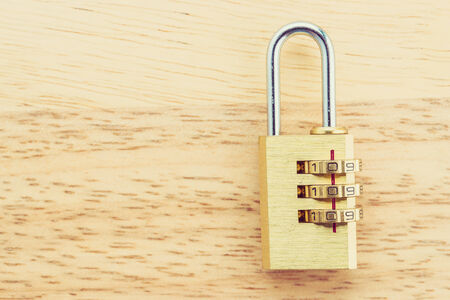 Key pad lock on wooden background process vintage style picture photo
