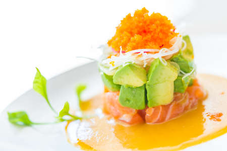 Tartar salmon with avocado salad - japanese food style photo