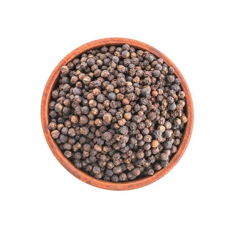 black pepper: Black pepper in wooden bowl isolated on white background Stock Photo